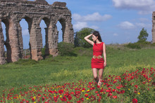 Young Woman In Red Dress Looki...