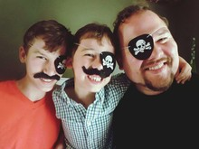 Portrait Of Smiling Family In Pirate Party
