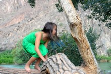 Little Girl Hiding Behind Tree...
