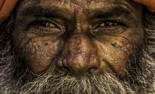Close-up Portrait Of Senior Beggar