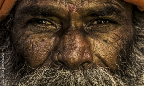 Photo Close-up Portrait Of Senior Beggar