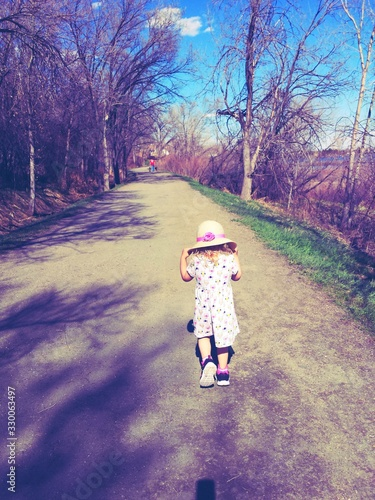 Full Length Rear View Of Girl Walking On Road Canvas Print