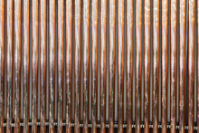 Background Of Vertical Copper Pipes. Copper Pipes For Connection