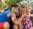 Loving Brother Kissing Sister