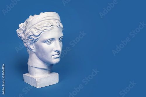 Marble head of young woman, ancient Greek goddess bust isolated on pink background Canvas Print