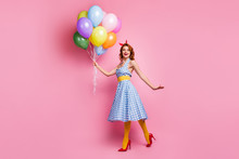 Full Body Photo Of Cheerful Dreamy Tender Gentle Pretty Girl Enjoy Anniversary Girl Lady Hold Many Helium Air Baloons Laugh Wear Blue Polka-dot Stockings Isolated Over Pink Color Background