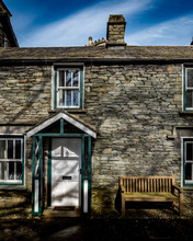 Traditional Slate Brick Cottages In The Rural English Lake District Town Of Grasmere Known As The Home Of Poet William Wordsworth.