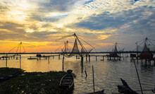 As Amazing As It Looks,sunsets On The Backwaters Of Kerala Are Truly Special. The Fishing Net And The Fishing Boats Portray The Life Of The People Around The Coastal Areas  Of Kerala, India.