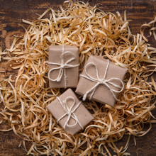 Three Small Gifts Are Wrapped ...