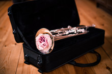 Trumpet With A Beautiful Rose Lies In Open Case