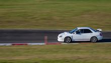Panning Shot Of A White Sportscar Cornering