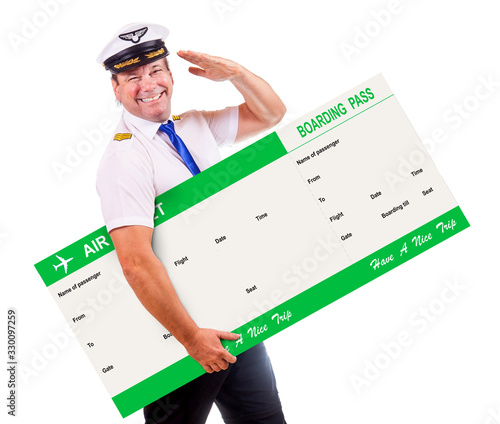 The cheerful pilot hold air ticket and salute with his hand, isolated on white background Canvas Print