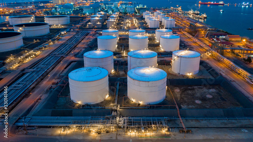 Fototapeta Aerial view oil and gas terminal storage tank farm,Tank farm storage chemical petroleum petrochemical refinery product, Business commercial trade fuel and energy transport by tanker vessel. obraz