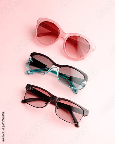 Sunglasses of various forms and colors in a row Fototapeta