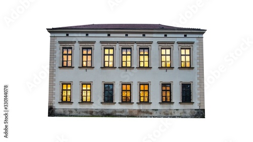 Low-rise 19th century european house isolated on white with warm lights in windows Poster Mural XXL
