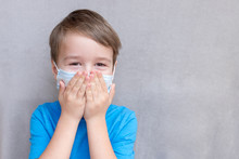 Portrait Of Toddler Kid Wearing Medical Mask.A Boy Wearing Mouth Mask Against Air Smog Pollution. Concept Of Coronavirus Quarantine Or Covid-19.Protection Against Virus And Infection Control Concept.