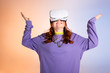 happy female teenager gesturing and using vr headset, on purple and beige