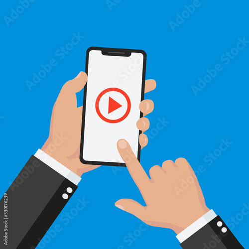 Fotomural Flat Design style hand holding smartphone with online media player app on screen