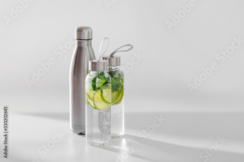 Vászonkép Fresh lime and mint infused water, cocktail, detox drink, lemonade in reusable bottles