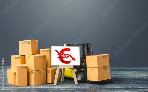 Photo Forklift near boxes and easel red euro symbol down arrow