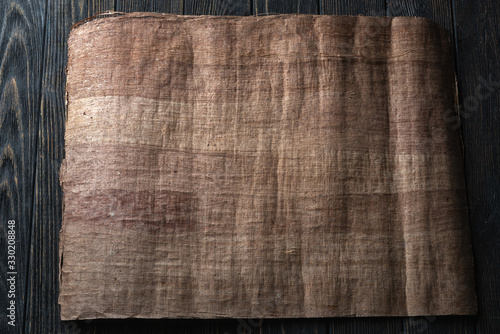 Papyrus on a black table top view Wallpaper Mural