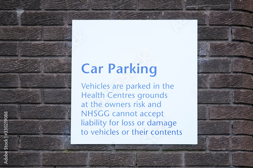 Car park sign unable to accept responsibility or liability for thief, loss or da Wallpaper Mural