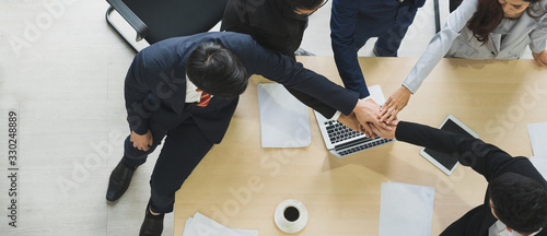 Asian business people putting their hands together. Canvas Print