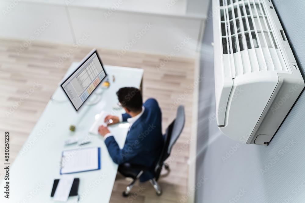 Fototapeta Businessman Enjoying The Cooling Of Air Conditioner