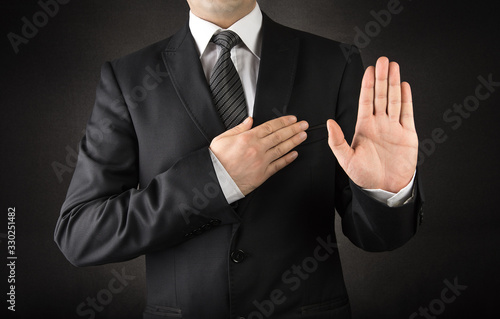 Men in suits taking oath Wallpaper Mural