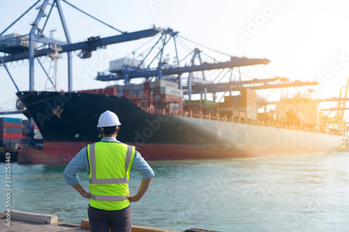 A foreman is looking at cargo operation at the port as for business and logistics shipping background Canvas Print