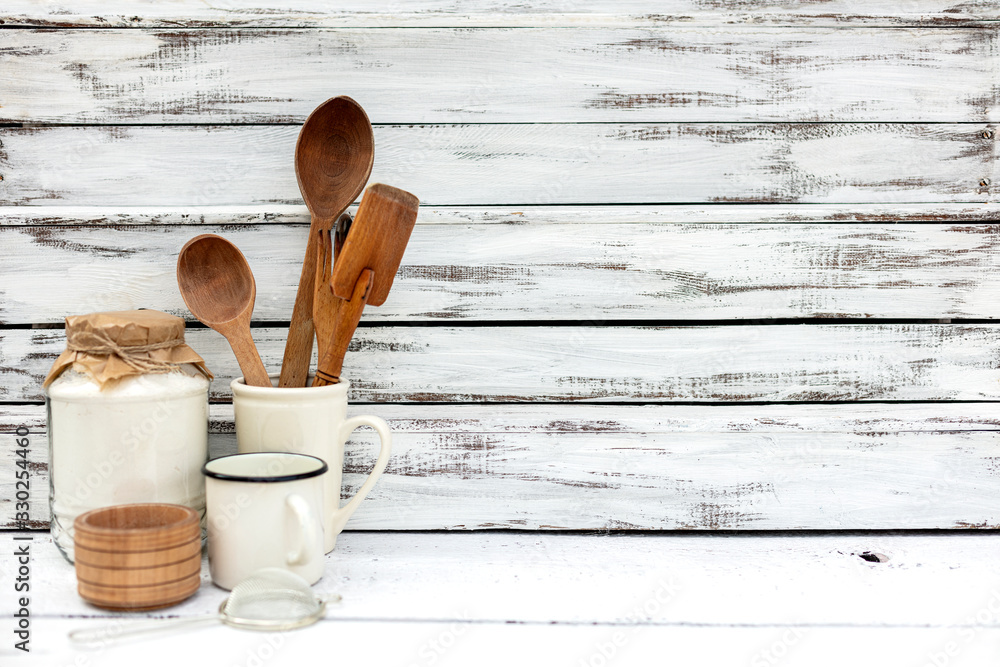 Fototapeta Vintage old baking utensils on a white wooden background.