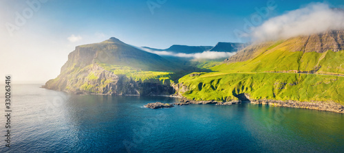 Obraz View from flying drone. Misty morning scene of Vagar island. Colorful summer scene of Faroe Islands, Kingdom of Denmark, Europe. Traveling concept background - fototapety do salonu