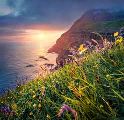 Fototapeta Morze Colorful summer scene from Sunset Viewpoint in Gasadalur village. Dramatic evening landscape of Vagar island. Fantastic seascape of Atlantic ocean, Faroe Islands, Kingdom of Denmark, Europe..