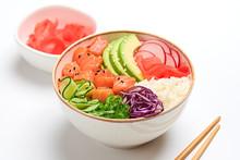 Hawaii Salmon Poke, Avocado, Rice, Seaweed, Cucumber, Radish, Carrot In Bowl. Home Made Vegetarian Poke. Seafood Concept. Asian Salmon Poke Salad On White Wood Background.