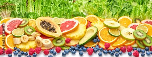 Fresh fruit berries green salad collection. Tropical papaya, pineapple, apple, orange, kiwi,mixed citrus salads food. Healthy fruity diet concept. Fruit background, banner