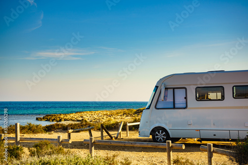 Camper car on beach, camping on nature Fototapet
