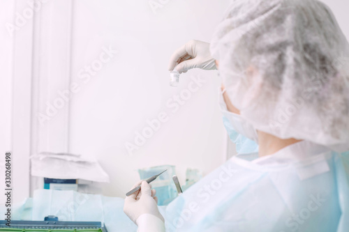 Photo Microsurgical instruments and anesthesia injection in doctor hands