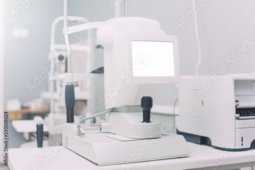 Auto Kerato Refractometer standing on a table in doctors office with empty screen mock up Canvas Print