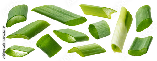 Leinwand Poster Chopped green onion isolated on white background, closeup