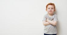 Portrait Of Redhead Boy Standi...
