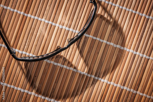 Photo Sunglasses on reed ground slant