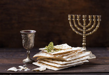 Red Kosher Wine With A White  Matzah Or Matza On A Vintage Wood Background Presented As A Passover Seder Meal With Copy Space.