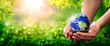 Hands Holding Planet Earth On Soil In Lush Green Environment With Sunlight - The Environment Concept - Some Elements Of This Image Were Provided By NASA