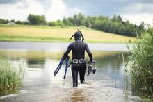 A Scuba Diver In A Wet Suit Pr...