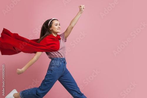 Superheroine, a young female superhero in a red Cape Canvas Print