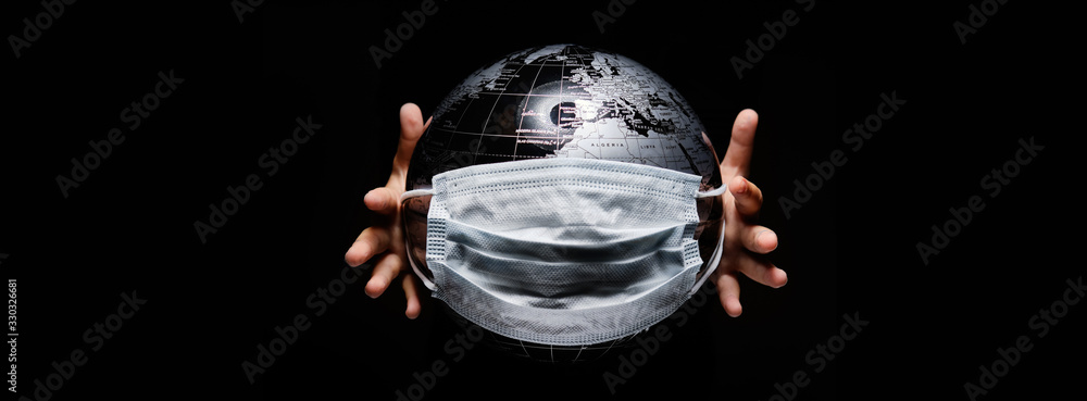 Fototapeta Kid holding globe map sphere isolated on black horizontal background. Ecological problems disasters. COVID-19 pandemic infection disease concept image, copy space for text