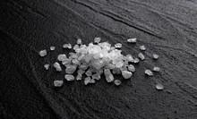 Pile Of Sea Salt On Black Back...