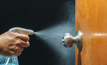 Cleaning Door Knob With Alcoho...