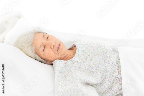 palliative care,  old Asian patient sleep on white bed, she feeling lonely, neck Canvas Print