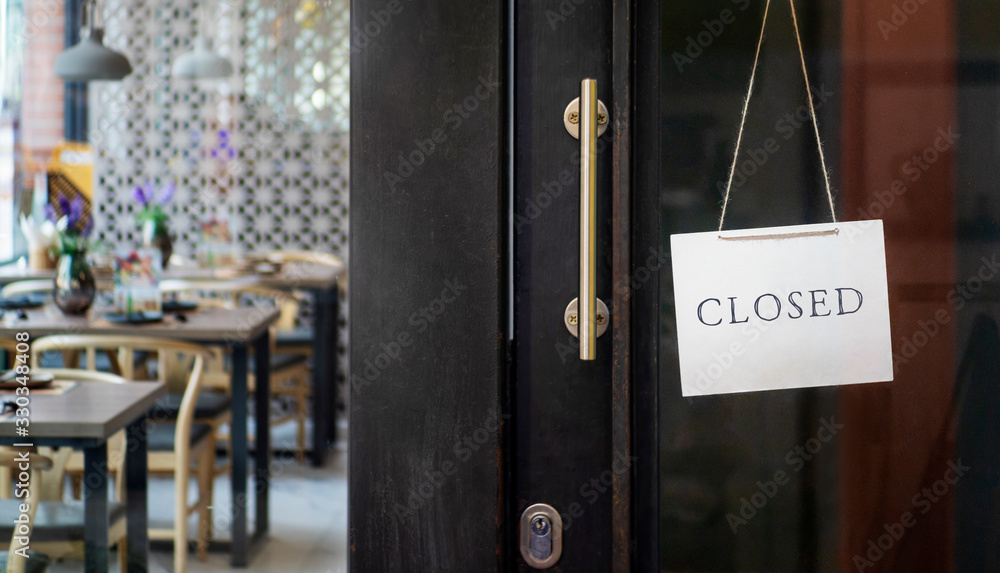 Fototapeta  closed sign hanging outside a restaurant, store, office or other